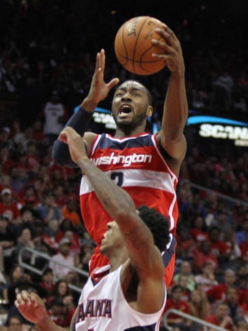 John Wall is averaging 17.4 points and 12.6 assists