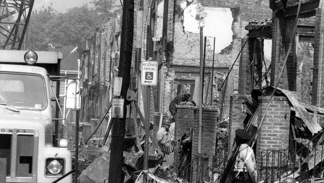 A (Cherry Hill, N.J.) Courier-Post file photo from May 18, 1985, showing the remains of the MOVE house in Philadelphia. An attempted eviction of the radical group led to a confrontation and bombing that resulted in a fire which killed 11 people, destroyed 61 houses and left 270 people homeless.