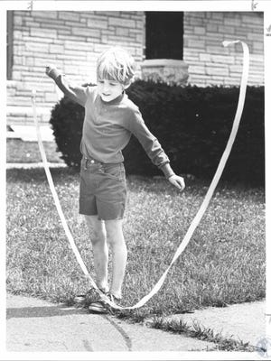 A young Dave Schroeder with his twirling whistle. Schroeder serves as the executive director of the Kenton County Public Library.