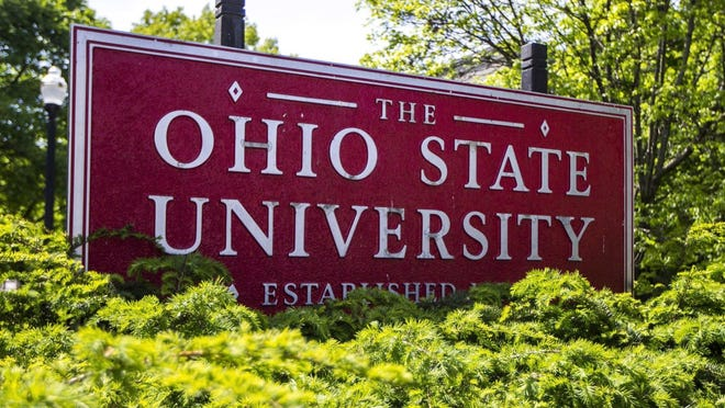 This May 8, 2019 photo shows a sign for Ohio State University in Columbus, Ohio. On Friday, May 17, 2019, the school said at least 177 men were sexually abused by Ohio State team doctor Richard Strauss who died years ago, according to findings from a law firm that investigated the accusations, concluding that school leaders knew at the time.
