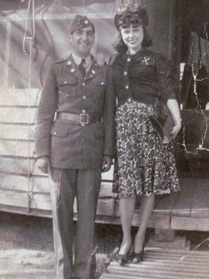Raymond Ferrer and his wife Angelica at an army base after his return to the United States following World War II.