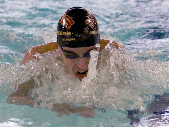 Kingston's Ethan Fox competes in the breaststroke leg