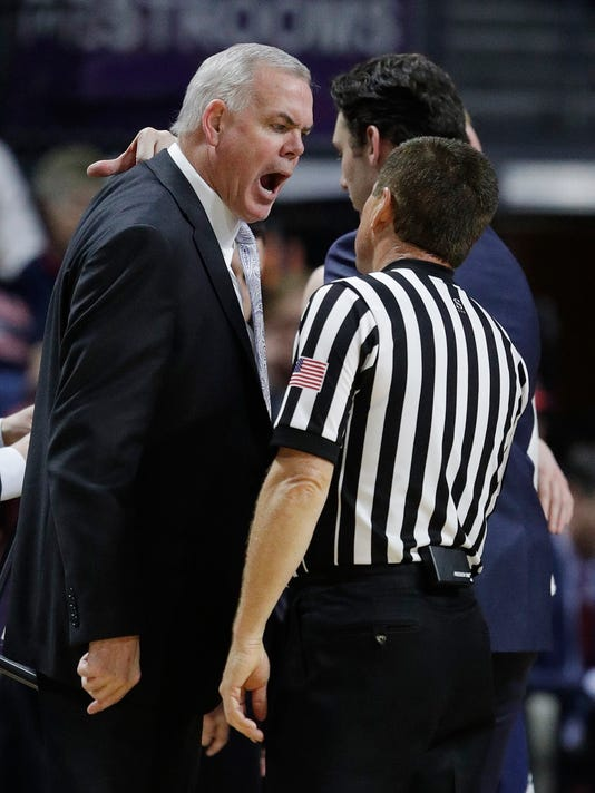BYU head coach Dave Rose, left, argues with an official during the first half of a West Coast Conference tournament NCAA college basketball game against Saint Mary's, Monday, March 6, 2017, in Las Vegas. (AP Photo/John Locher)