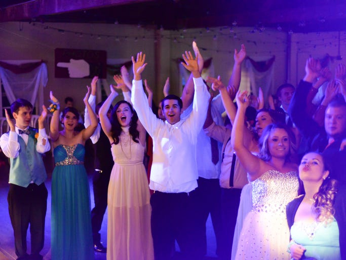 Students from Central High School in Independence, Ore. celebrate their Carnival themed prom tab the Green Villa Barn on Sat. April 26, 2014.