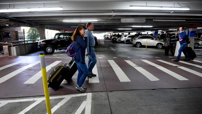 Air travelers arriving and leaving McGhee Tyson Airport Friday, Nov. 17, 2017.