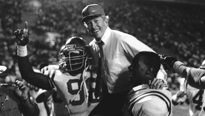Then-Ole Miss coach Billy Brewer is carried off the field.