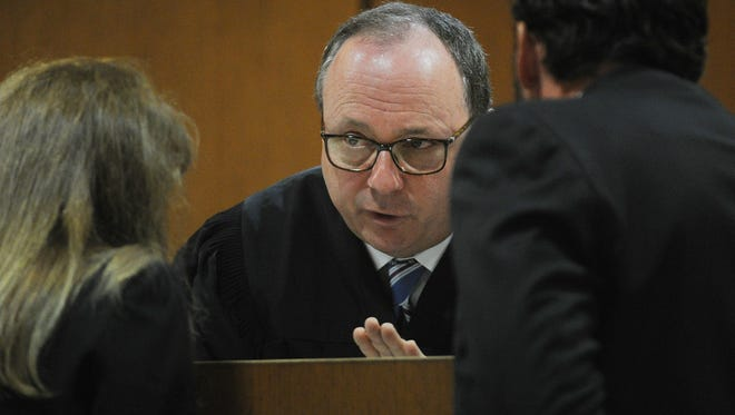 Judge Matthew Guasco, center, talks with Rebecca Day, senior deputy district attorney, and Justin Tuttle, senior deputy public defender, earlier this month during the opening arguments of Kevin Hogrefe's trial in Ventura County Superior Court.
