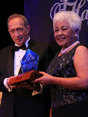 Jim Adkins, center, and Rosita Adkins, right, were inducted into the Guam Business Hall of Fame during the Guam Chamber of Commerce 89th Anniversary Gala at the Hyatt Regency Guam in 2013,