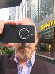 Ed Baig takes pictures with the Kodak Ektra in Manhattan