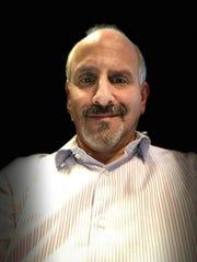 A Portrait Mode selfie automatically can darken the background.