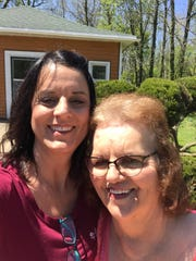 Laura DeLong with her mother Beverly Crawford. Crawford