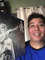 Jay Cairo of KWSS-FM with the Bowie record he picked up at Stinkweeds