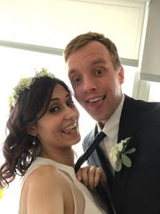 Ricky Smith and Mona Ashraf Khorasani share a funny moment after they married in a small ceremony in Canada in March 2018. They are trying to get Mona a travel ban waiver so she can live in the U.S.