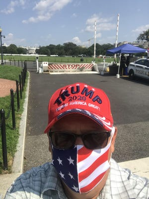 Utica resident James Zecca stands outside the White House lawn on Thursday, July 27, 2020. Zecca was invited to attend President Donald Trump's speech on the last night of the Republican National Convention.