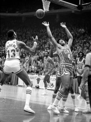 NBA legend Wes Unseld, right, died Tuesday morning at the age of 74.