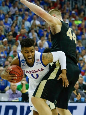 Kansas Jayhawks guard Frank Mason III (0) collides with Purdue Boilermakers center Isaac Haas (44) during the first half in the semifinals of the midwest Regional of the 2017 NCAA Tournament at Sprint Center.