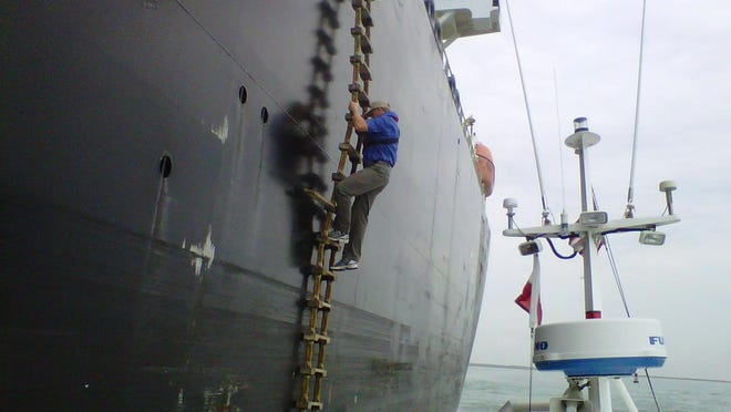 A view from the side of the boat as a transfer is made.