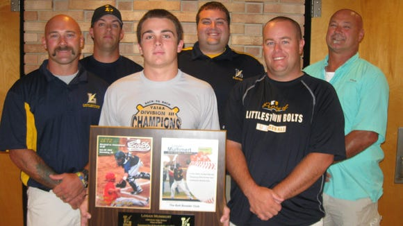 Pictured from left to right: Dusty Reynolds(Coach), Doug Arnold(Coach), Logan Mummrt, Drakr Dangelo(Athletic Director), Todd Gantz(Coach), Randy Reynolds(Booster Club)