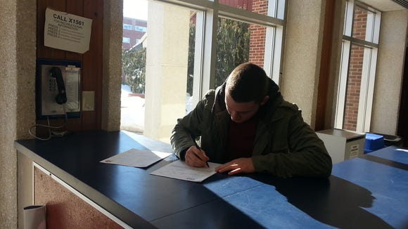 John Ford signs his letter of intent to play college football for Shippensburg. (SUBMITTED)