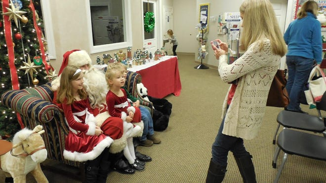 Children enjoy visiting with Santa during the 2014 Holiday Open House at the Pike Road Library.