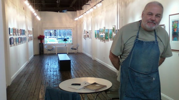 Phillips in his gallery with his current show featuring six contemporary artists.