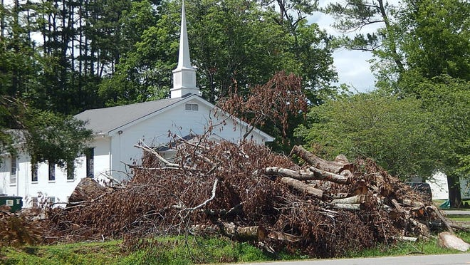 Reminders of the Easter Sunday tornado remain along U.S. 11 and other roadways, as Etowah County awaits word on whether reimbursement for clean up expenses will be coming.