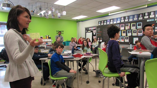 Whether all students return to class remains in question. Here, Carla Haas, a sixth grade teacher at George G. Dodge Intermediate School in Twinsburg, talks to her class.