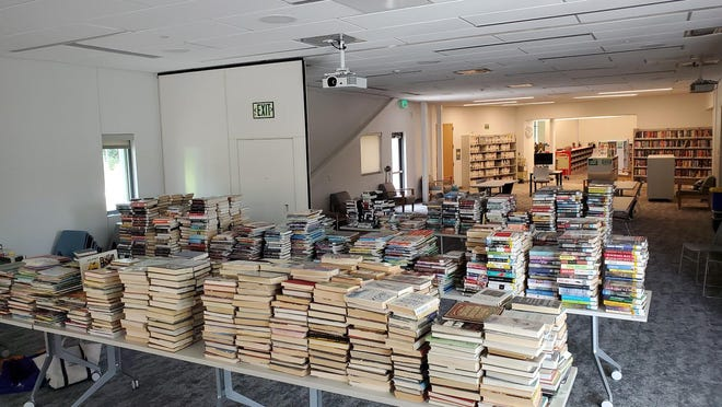 Books undergoing quarantine at the Pine Valley branch of the New Hanover County Library before they are returned to the shelves.