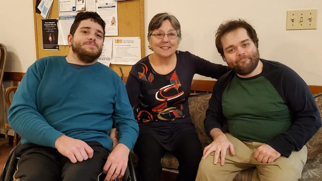 Douglas, Laurie and Alex McIntosh attend a Friday, Jan. 3 party in Dover to celebrate the beginning concept of Our Place Inc., a planned residential home for adults with developmental disabilities. Laurie McIntosh hopes to place the home in the greater Dover area.