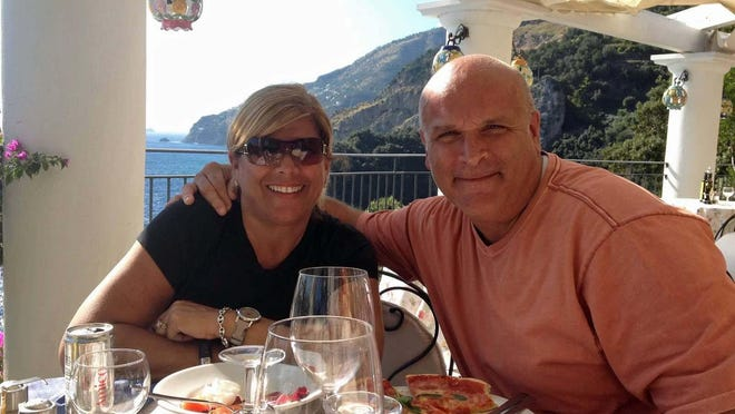 Cheryl and Mario Micheletti on a trip to the Cinque Terre, a coastal area on the coast of Italy. They hope to travel again when it's allowed.
