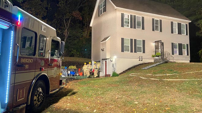 Dover firefighters work to extinguish a dryer fire at an Upper Factory Road home Friday night. Residents were able to quickly evacuate the home thanks to interconnected smoke detectors.