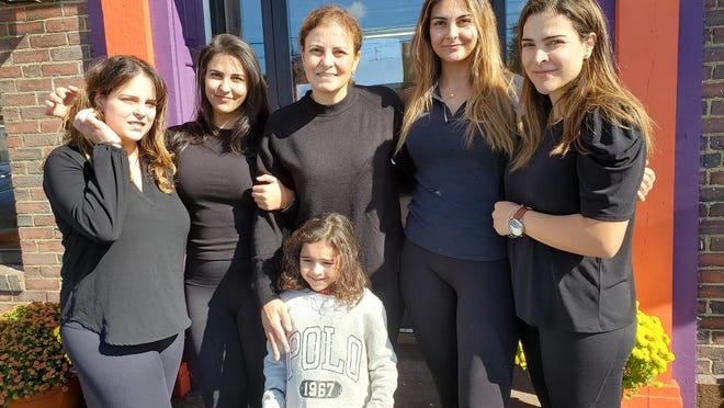 The Fakhoury family, daughters and widow of the late Amer Fakhoury, are preparing to reopen Little Lebanon To Go restaurant in Dover on Tuesday. From left are Amanda, Macy, Michelle, Zoya and Guila with 4-year-old Kira in front.