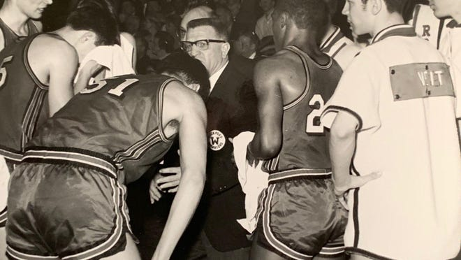 Rockford West coach Alex Saudargas, center, talks with his players during a game in the 1967 season, when the Warriors finished were undefeated until the state semifinals and finished fourth.