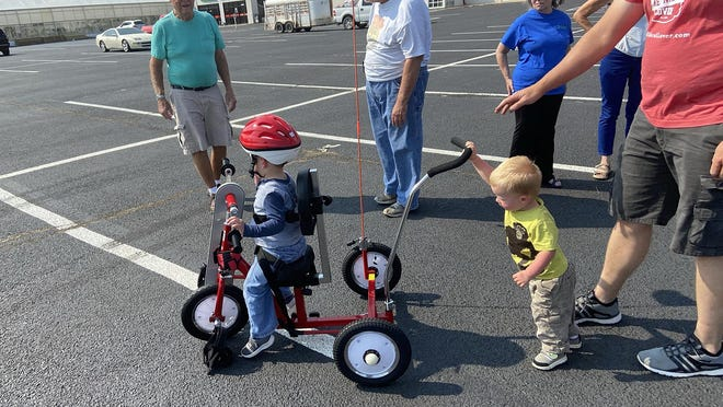 Boe Wiens, 3, received a new Amtryke from Dodge City AMBUCS in partnership with Swaim Funeral Home of Dodge City. His little brother had no problem pushing him around.
