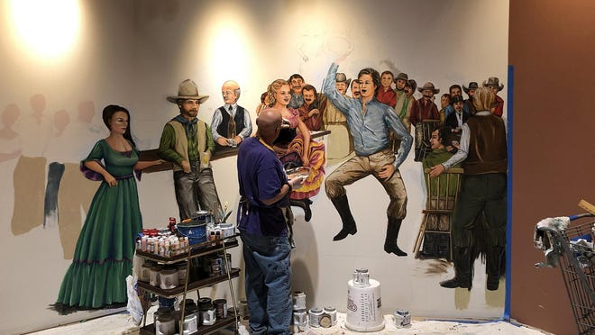 Dave Wetmore works on one of the six murals he was commissioned to paint for Boot Hill Museum as part of the STAR Bonds expansion.