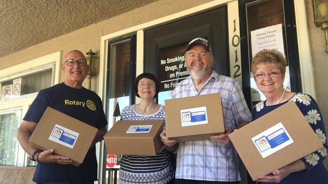 Rotarians Dave Wetmore and Jan Scoggins of the Rotary Club of Dodge City picked up 60 food boxes District Governor Sterling Hall of Rotary District 5680 to delivery to Manna House Food Pantry and the Salvation Army of Dodge City. Each box can provide 42 meals. SUBMITTED PHOTO