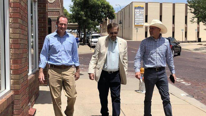 Kansas 1st Congressional District candidate Tracey Mann, Sen. Bud Estes and Shane Bangerter, of Bangerter Law, P.A., walk recently in Dodge City.