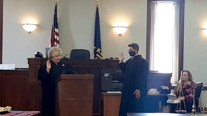Andrew M. Stein is sworn in as a 16th Judicial District Judge by Chief Judge Laura H. Lewis.