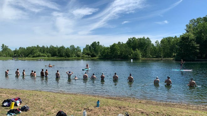 West Michigan Swimmers athletes prepare for a social distancing open water swim.