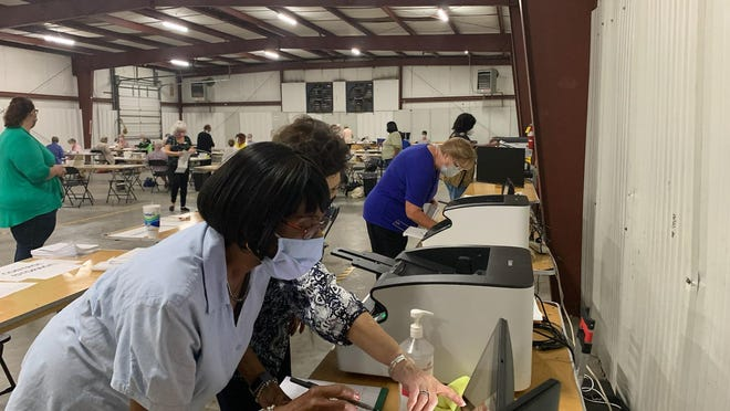 Chatham County Board of Elections workers begin processing absentee ballots on Tuesday.