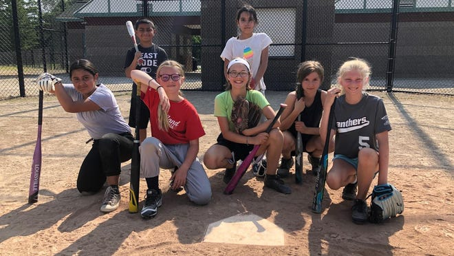 Sandlot players pose for a picture. Back row, left to right: E.J. Trevino and Isabell Serrano. Front row: Nayeli Trevino, Maggie Telgenhof, Penelope Grob, Rylee and Lil Gitler.