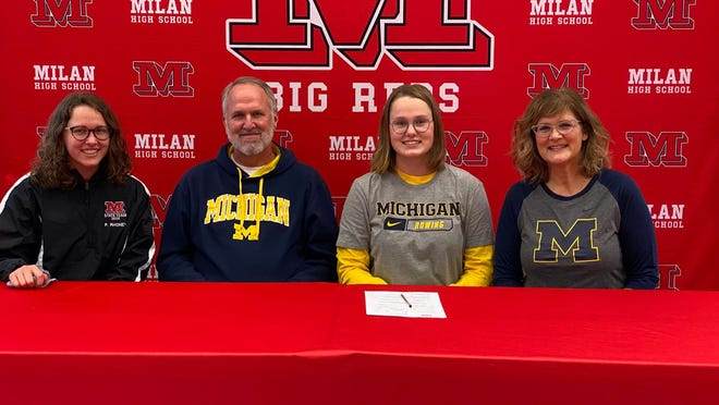 Jillian Rhoney signs her commitment to the University of Michigan with her parents, Richard and Kim Rhoney, and her sister, Phoebe.