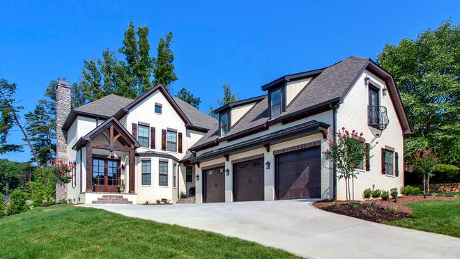 The home in the photo has been modified from the plan to have a third garage bay – a smart choice for a large family.
