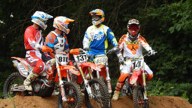 Pictured are, from left, Fred Andrews, Chris Blankenship, Craig Morgan and Kevin Windham Sunday morning in Vanleer during a motocross stunt exhibition.