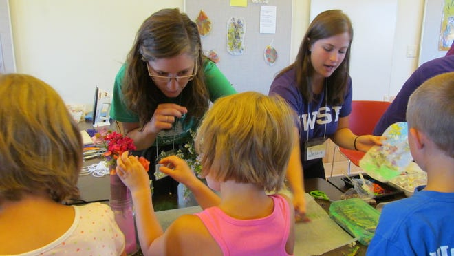 Children make wildflower stained-glass creations during a Grandparents Day event Sunday at Mead Wildlife Area in Milladore.