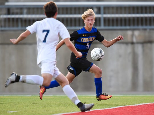 St. Cloud Cathedral's Jake Minkkinen takes the ball