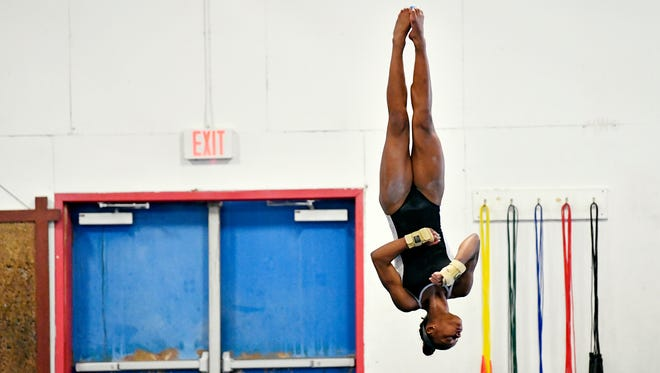Trinity Thomas completes a floor exercise Friday, May 11, 2018, at Prestige Gymnastics in West Hempfield Township, Lancaster County. Thomas, a member of the U.S. national team, has expanded her athletic repertoire in her senior year to include diving in the winter season and pole vault and track in the spring season.