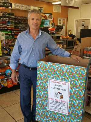 Ted Moon, regional director of the area 7-11s, stands with a donation box. Items will be collected through October.