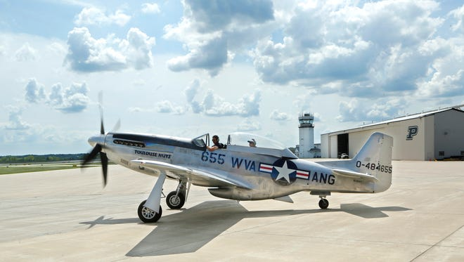A P-51C Mustang taxis to a runway Monday, August , 2016, at the Purdue University Airport. The plane was part of the Wings of Freedom Tour featuring vintage WWII planes.