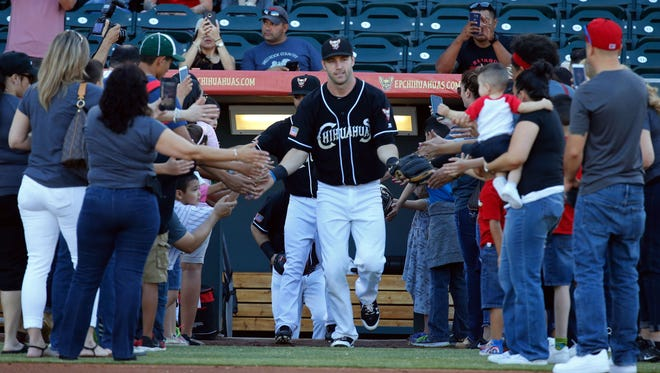 The El Paso Chihuahuas baseball team takes the field for another game played at Southwest University Park Thursday night against the Albuquerque Isotopes.